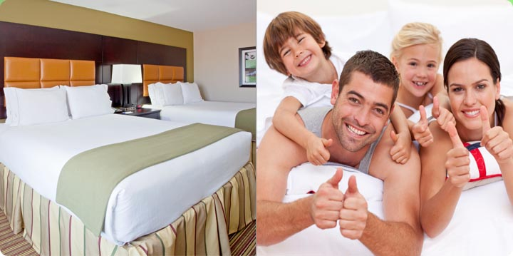 Arlington Texas Hotel Suite with Two Beds Accommodations smiling family in bed